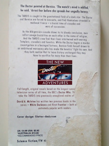 "Back cover of a dog-eared ""New Adventures"""